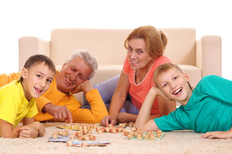Family at home. Cute family having a fun at home stock images