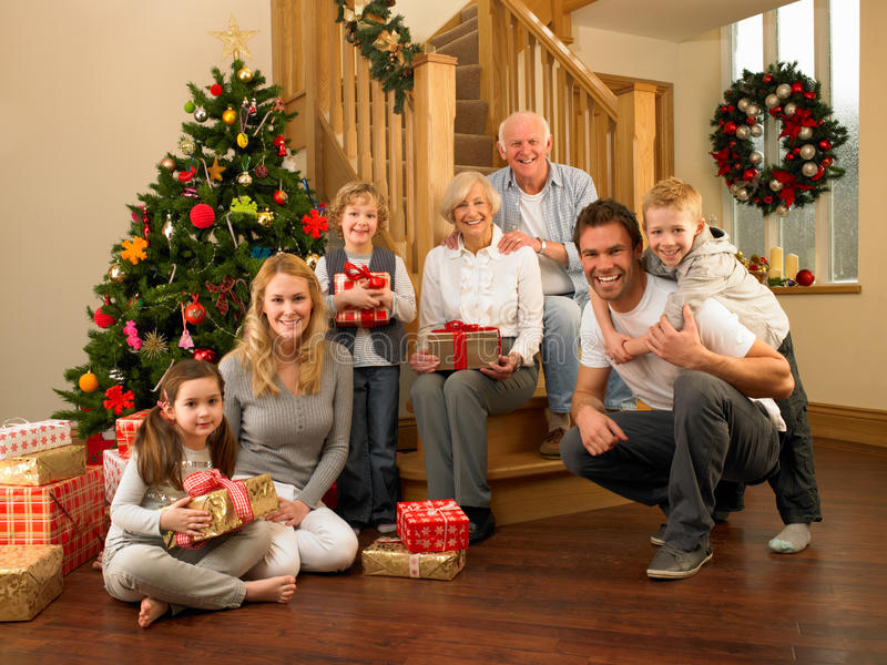 Family at home around christmas tree stock photography