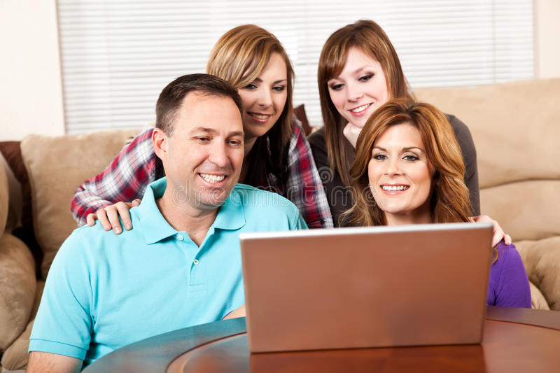 Family At Home Browsing Internet Royalty Free Stock Photography