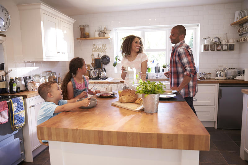 Family At Home Eating Breakfast In Kitchen Together royalty free stock images