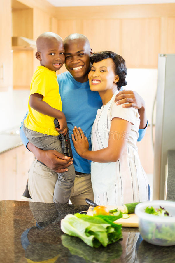 Family in home kitchen. Portrait of lovely afro american family in home kitchen royalty free stock image