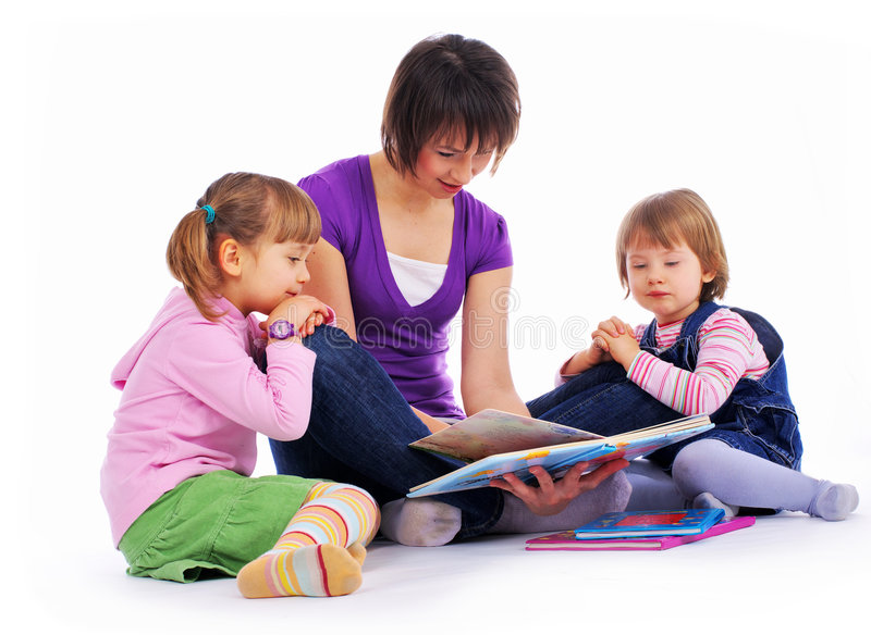Family at home reading book. Studio isolated shot stock image