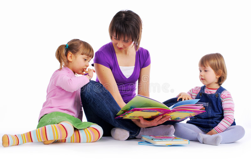Family at home reading book. Studio isolated shot stock photos