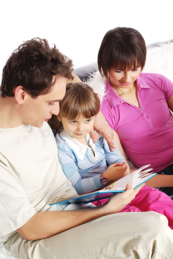 Family at home reading book. Studio shot royalty free stock images