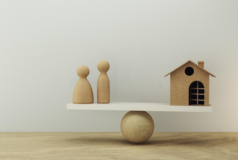 Family and house a balance scale in equal position. Family financial management, cash advance concept : depicts short term. Borrowing for a residence royalty free stock photography