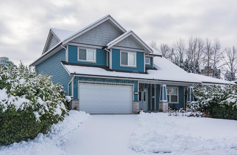 Family house in snow on winter cloudy day royalty free stock images