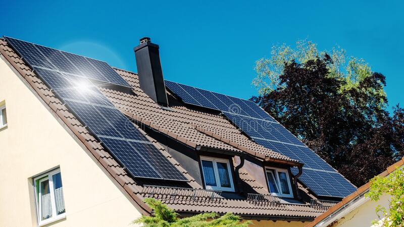 Family house with solar panels on the roof. A family house with solar panels on the roof royalty free stock photo