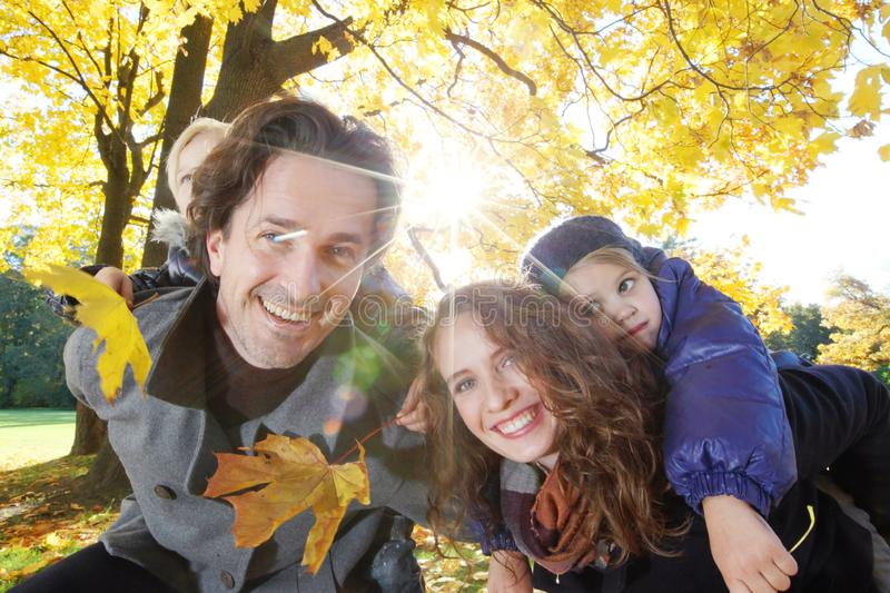 Family hug in autumn park royalty free stock images