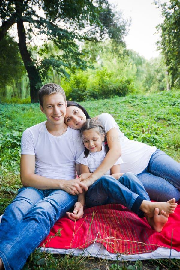Family hugs in the park royalty free stock photo