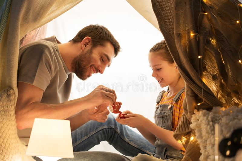 Family playing tea party in kids tent at home royalty free stock photography