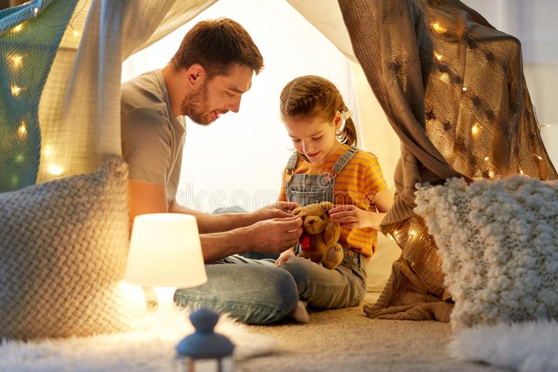 Happy family playing with toy in kids tent at home royalty free stock photos