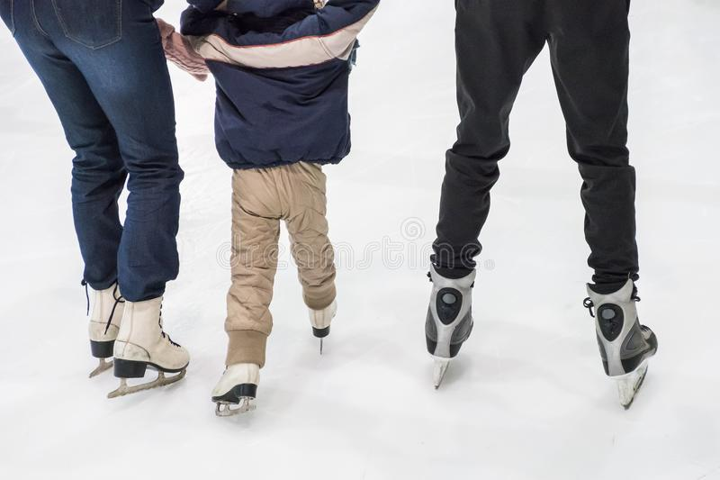 Family ice skating at rink. Winter activities. Happy family ice skating at rink. Winter activities stock photos
