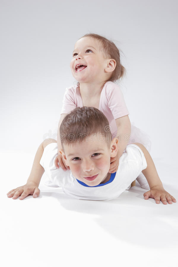 Family Ideas and Concepts. Portrait of Happy and Smiling Children Playing Together Underneath. stock photo