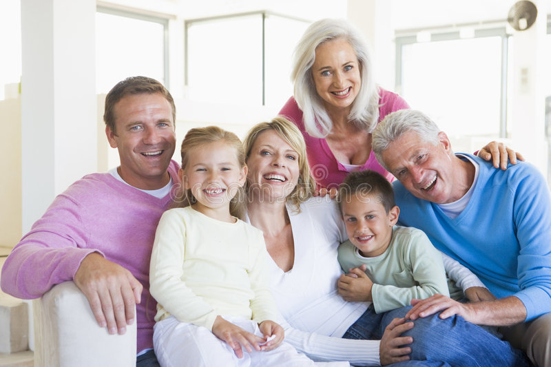family indoors sitting smiling