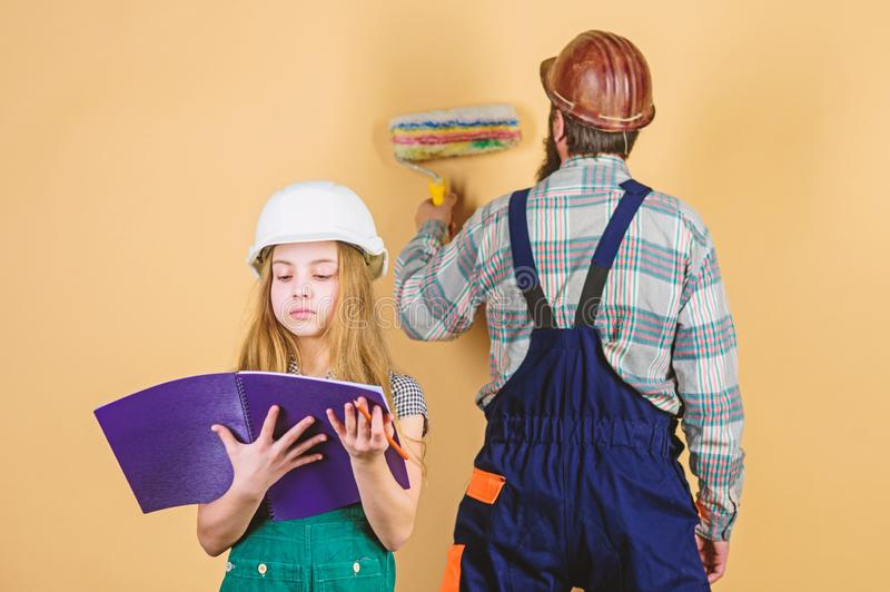 Family. Industry. Tools for repair. man with little girl. engineering education. construction worker assistant royalty free stock images