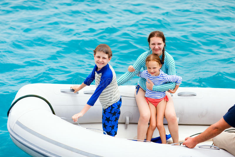 Family in inflatable dinghy boat. Family with kids having a ride on inflatable dinghy boat royalty free stock images