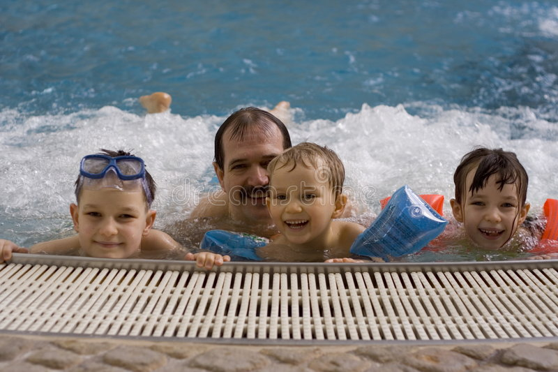 Family In Jacuzzi Stock Photos