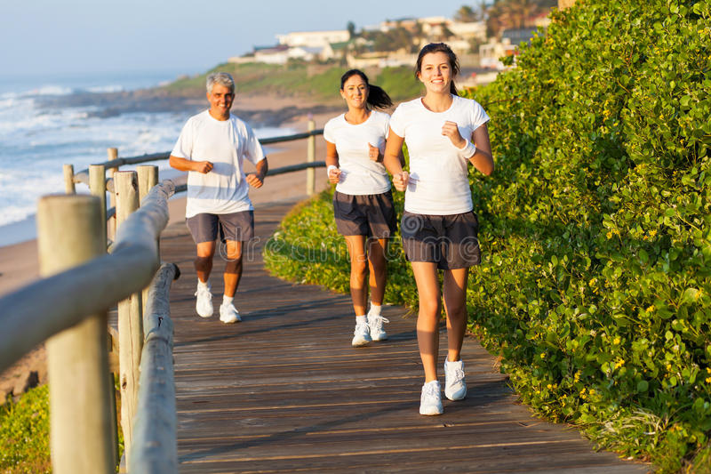 Family jogging beach royalty free stock photo
