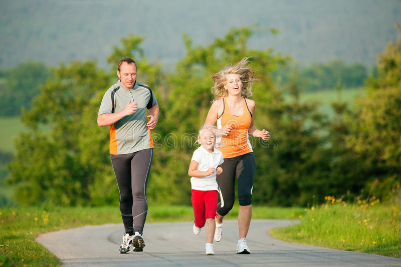 Download Family Jogging Outdoors Stock Photo - Image: 12249850