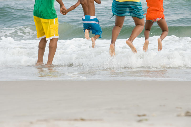 Family jumping stock image
