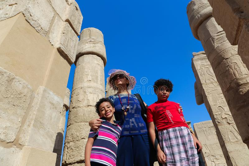 Family at Karnak Temple at Luxor - Egypt. Architecture of Karnak Temple at Luxor - Egypt Karnak temple most huge temple at Egypt stock image