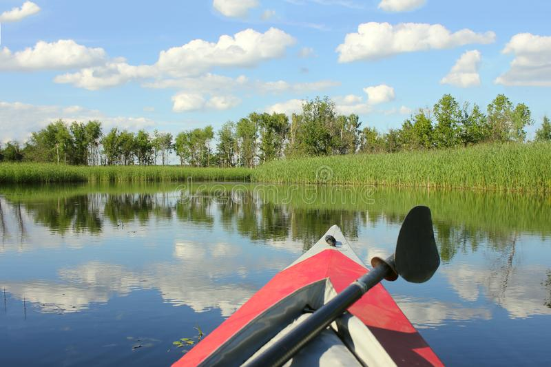 Family kayaking, canoeing on the river, active summer weekend and vacation, the concept of sport and fitness royalty free stock photography