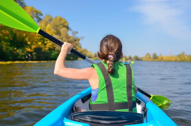 Family kayaking, child paddling in kayak on river canoe tour, kid on active autumn weekend and vacation. Sport and fitness concept royalty free stock photos
