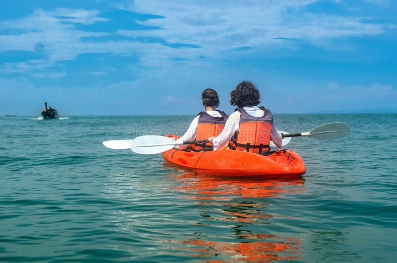 Family kayaking, mother and daughter paddling in kayak on tropical sea canoe tour near islands, having fun, active vacation stock images