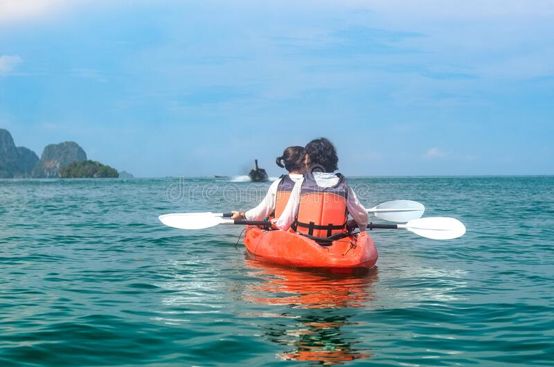 Family kayaking, mother and daughter paddling in kayak on tropical sea canoe tour near islands, having fun, active vacation royalty free stock photography
