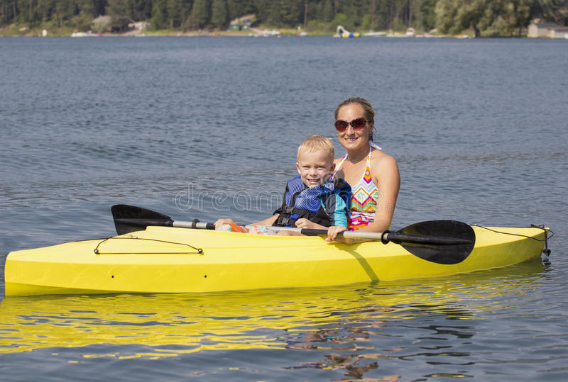 Family Kayaking together on a beautiful lake stock photography