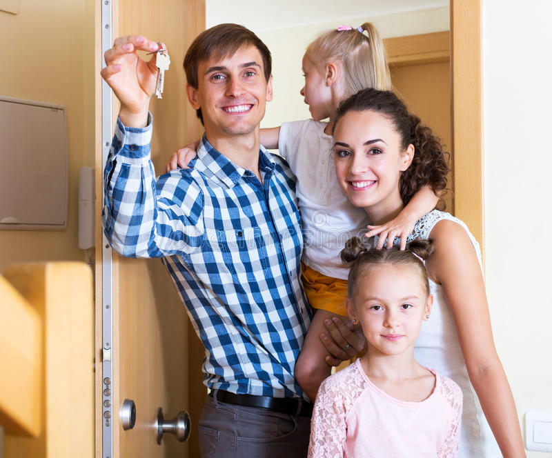 Family and keys new apartment royalty free stock image