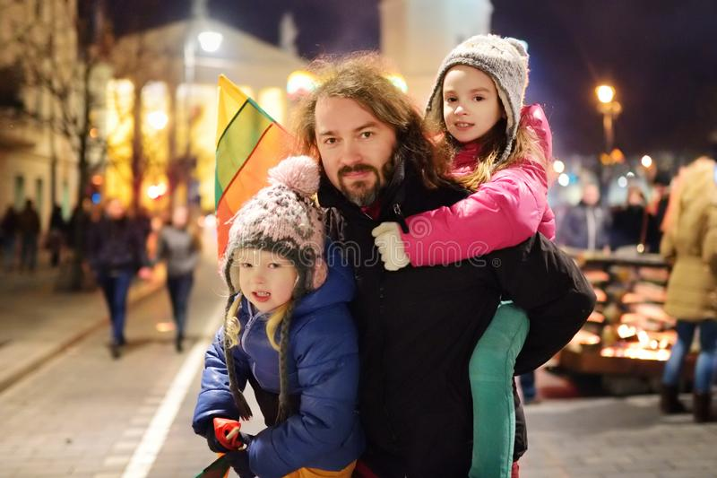 Family with kids attending the celebration of Restoration of the State Day in Vilnius, Lithuania. Bonfires are lit on Gediminas royalty free stock photo