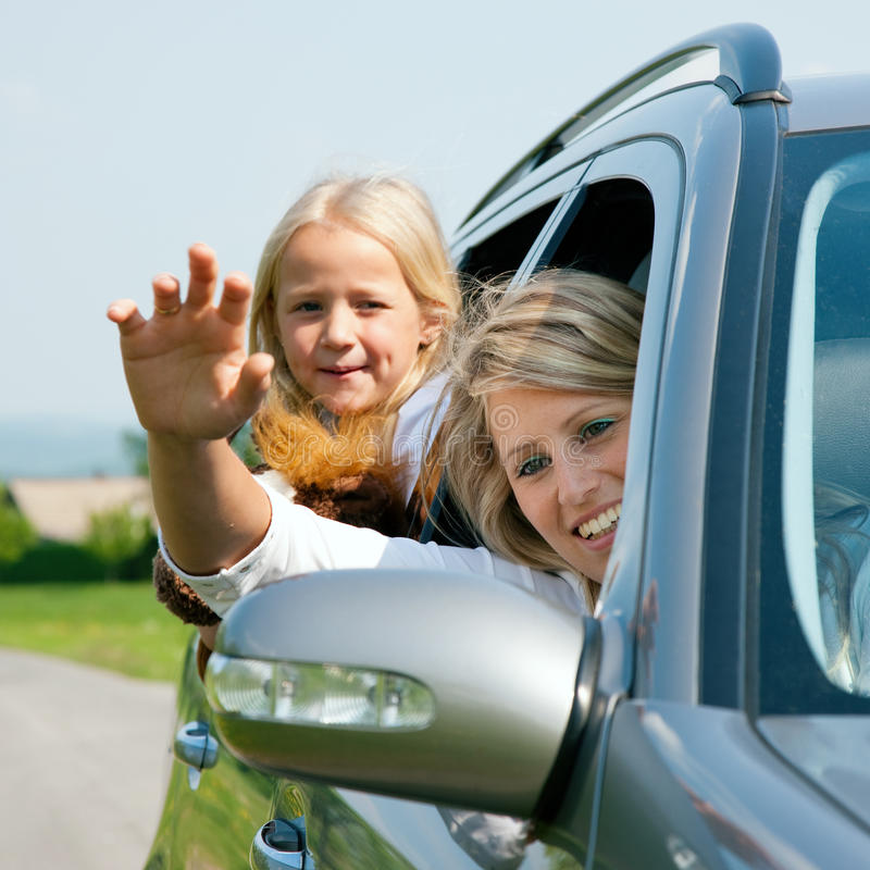 Family with kids in a car royalty free stock image