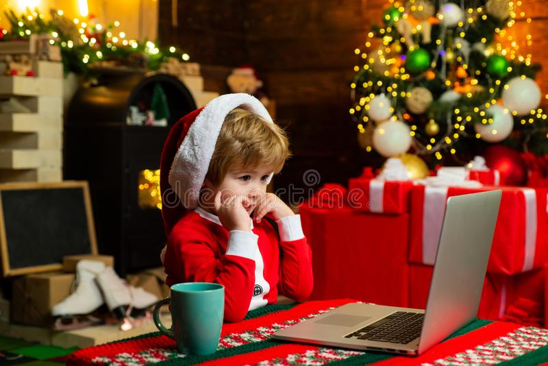 Family with kids celebrating Christmas at home. New Year surprise present. Joy and happiness. Boy child with laptop near stock photos
