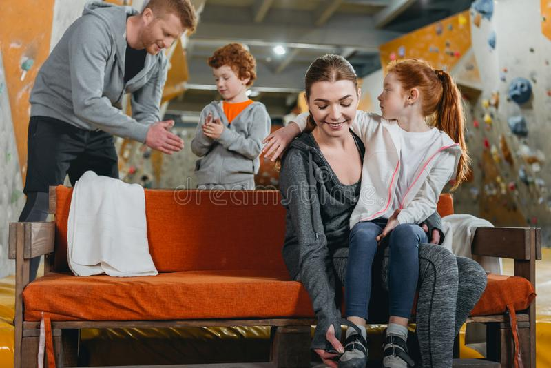 A family with kids at gym changing clothes and preparing to climb. A wall stock photos
