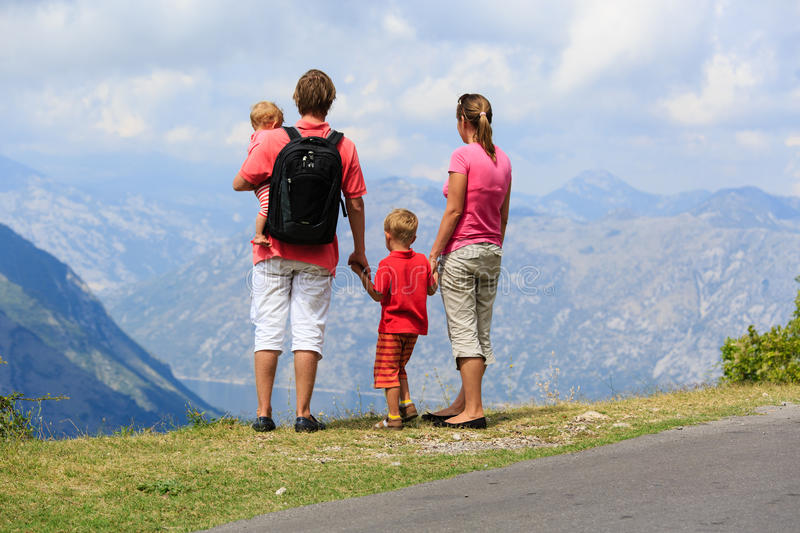 Family with kids looking at mountains stock photo