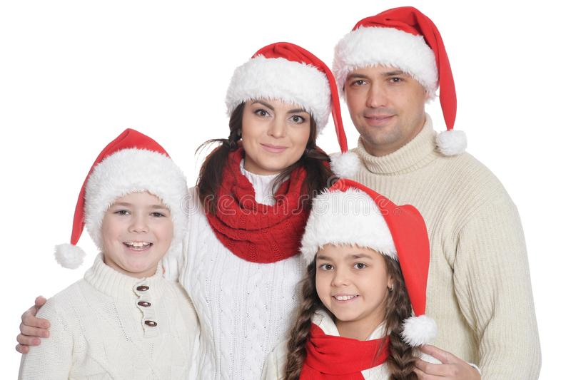 Portrait of family with kids in santa hats. Family with kids in Santa hats posing on white background stock image