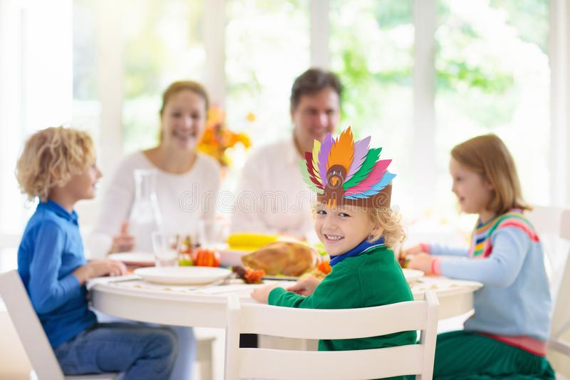 Family with kids at Thanksgiving dinner. Turkey royalty free stock photo