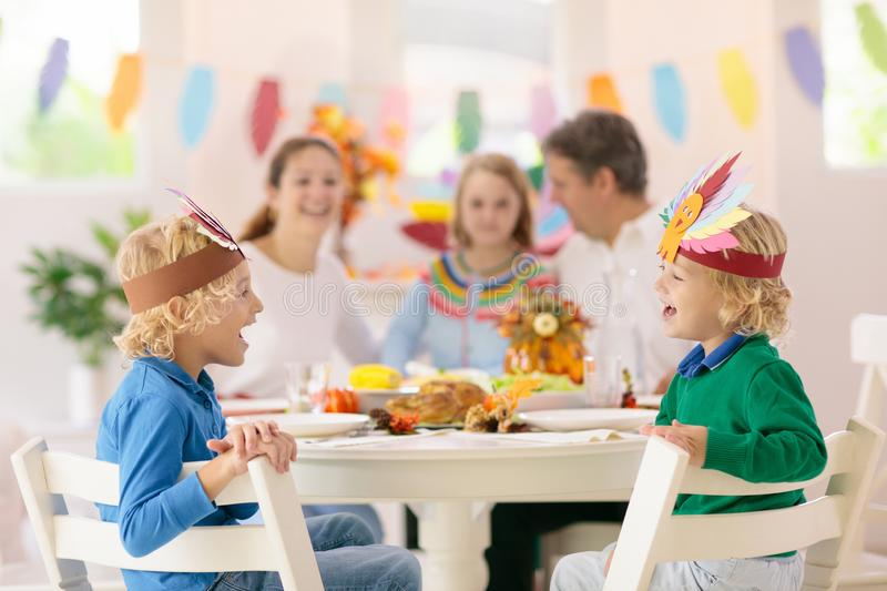 Family with kids at Thanksgiving dinner. Turkey royalty free stock photos