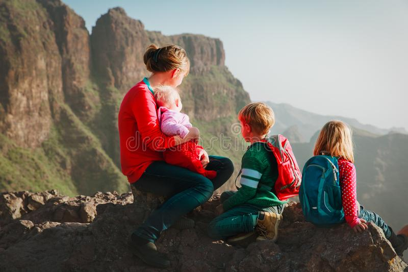 Family with kids travel hiking in mountains looking at view stock photos