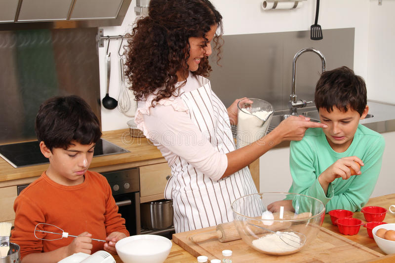Family in the kitchen royalty free stock images
