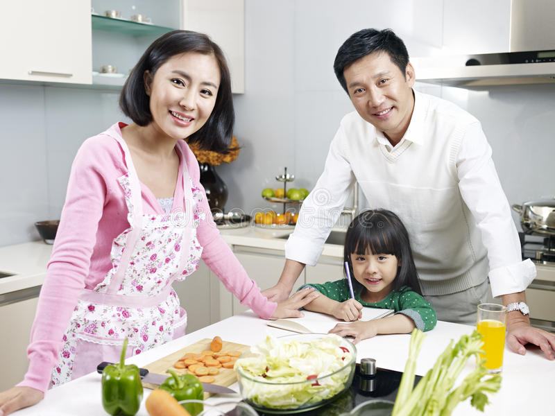 Family in kitchen stock photo