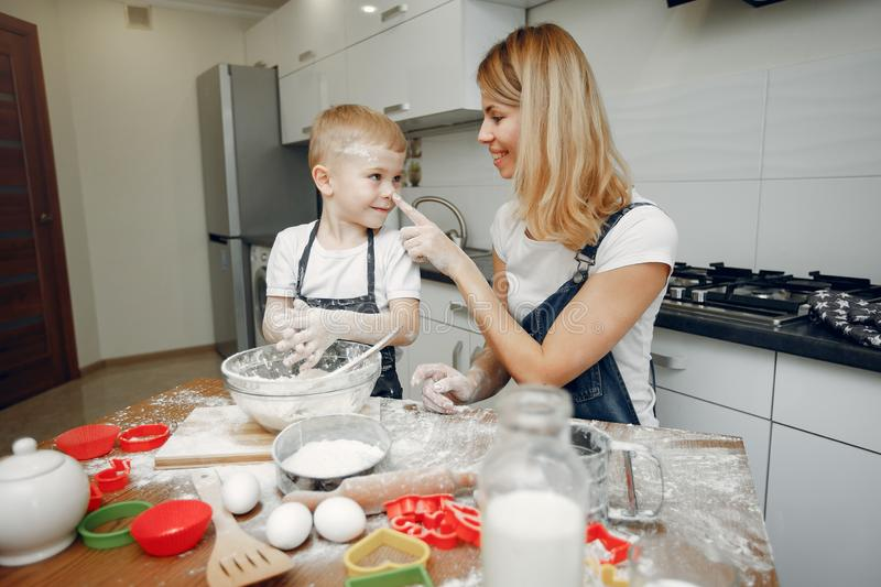 Family cook the dough for cookies royalty free stock image