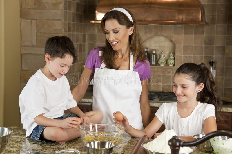 Family In Kitchen Cooking & Baking Stock Photos