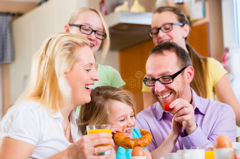 Family in kitchen having breakfast together stock images