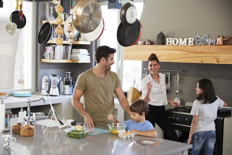 Family In Kitchen Making Morning Breakfast Together stock photo