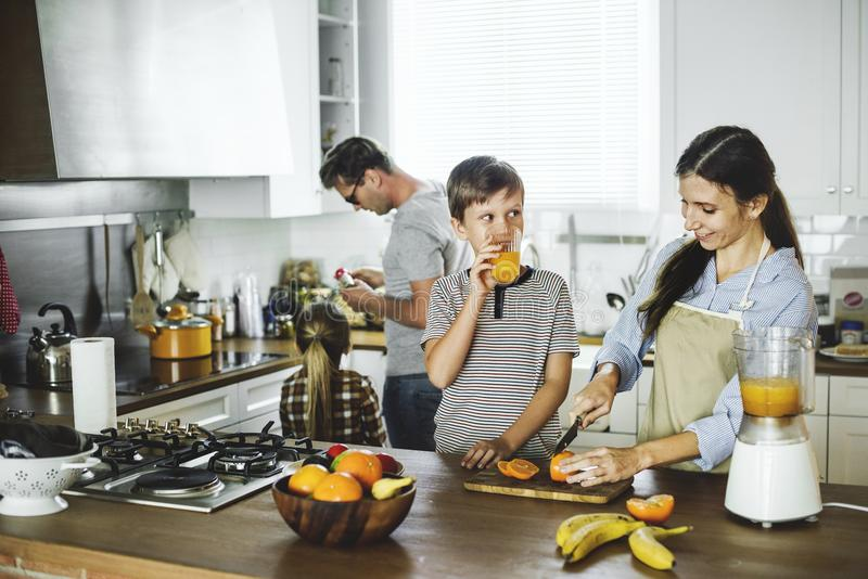 Family in the kitchen together royalty free stock images