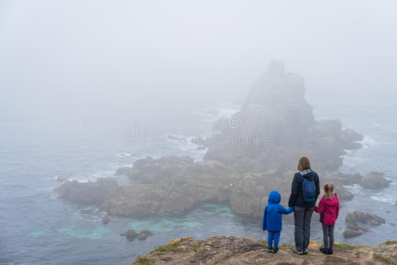Family on the Lands End in Cornwall royalty free stock photo