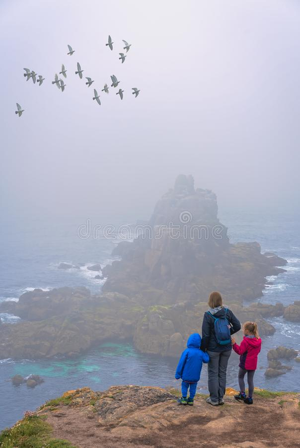 Family on the Lands End in Cornwall stock photos