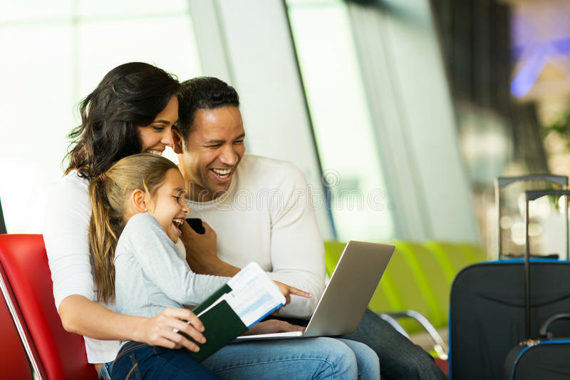 Family laptop airport royalty free stock image